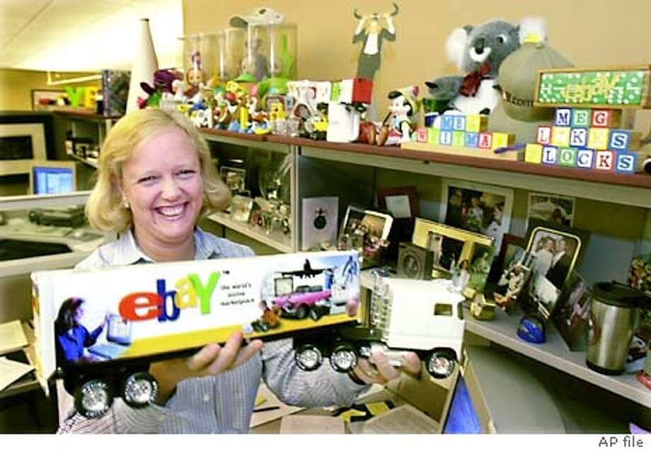 ADVANCE FOR SUNDAY MAY 27--EBay Chief Executive Officer Meg Whitman holds up an eBay promotional toy truck in her office in San Jose, Calif., Monday, May 21, 2001. EBay has managed to keeps its financial picture rosy in discouraging times. (AP Photo/Paul Sakuma) ALSO RAN: 06/10/2001 Photo: PAUL SAKUMA