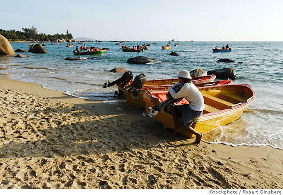 End of the Earth beach, Hainan Island, China Photo: IStockphoto / Robert Ginsberg
