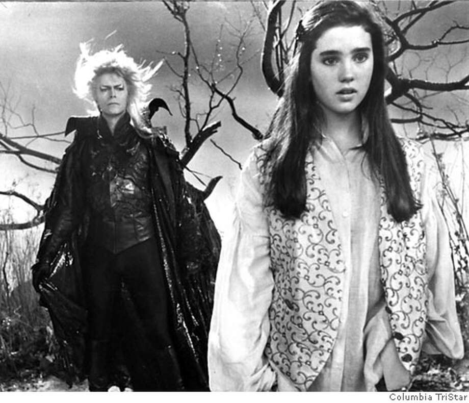 a handout from the film, Labyrinth. Jareth (David Bowie) tells Sarah (Jennifer Connelly) that she only has 13 hours to rescue her baby brother. Photo: Tri-Star Pictures Inc.