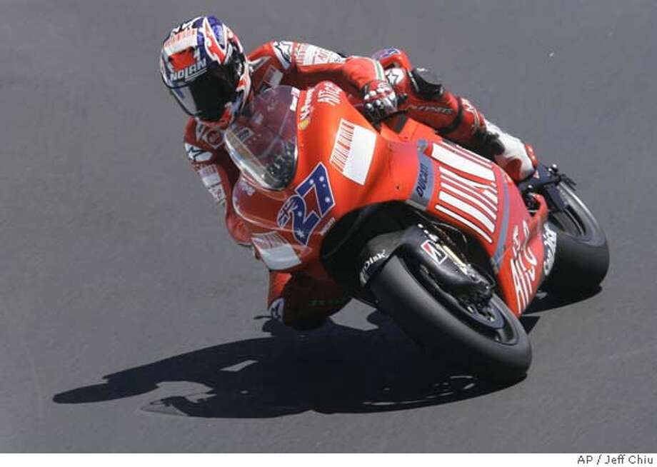 Casey Stoner, of Australia, races during qualifying practice at the Red Bull U.S. Motorcycle Grand Prix in Monterey, Calif., on Saturday, July 21, 2007. Stoner finished first in qualifying with a time of 1:22.292. (AP Photo/Jeff Chiu) Photo: Jeff Chiu