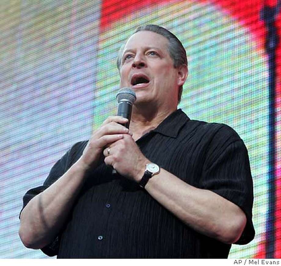 Al Gore speaks to the crowd at the Live Earth concert at Giants Stadium, Saturday, July 7, 2007 in East Rutherford, N.J., that was part of a 24-hour series spanning seven continents to raise awareness for global warming. On Wednesday July 11, 2007, in Trenton, N.J., a scientific report, Confronting Climate Change In The U.S. Northeast, was released. Wilting heat, deadly storms, flash floods, coastal erosion and more days with unhealthful air are just some of the effects of rising temperatures on the northeast, a group of scientists reported Wednesday. urging governments to take steps now to avoid the most devastating consequences of global warming. (AP Photo/Mel Evans) A JULY 7, 2007 PHOTO Photo: Mel Evans