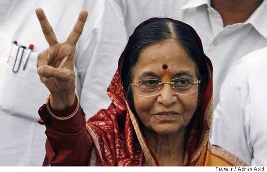 India's newly elected President Pratibha Patil gestures after her victory in New Delhi July 21, 2007. India elected its first female president on Saturday, official results showed, in what supporters called a boost for the rights of millions of downtrodden women, despite a bitter campaign marked by scandal. REUTERS/Adnan Abidi (INDIA)  Ran on: 07-22-2007  Pratibha Patil's election is seen as helpful to women's rights. Photo: ADNAN ABIDI