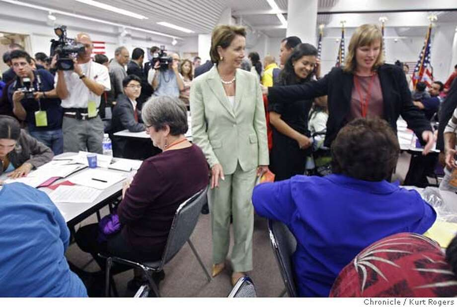 Nancy Pelosi after her talk she went through the room meeting people who were volunteering and also those who were filling out paper work for citizenship. House Speaker Nancy Pelosi came to the citizenship workshop at the Bill Graham Civic Auditorium in San Francisco this is the second year that the House Democrats have held workshops across the country to help legal residents obtain citizenship.  SATURDAY, JULY 21, 2007 KURT ROGERS SAN FRANCISCO SFC  THE CHRONICLE PELOSI_0030_kr.jpg MANDATORY CREDIT FOR PHOTOG AND SF CHRONICLE / NO SALES-MAGS OUT Photo: KURT ROGERS