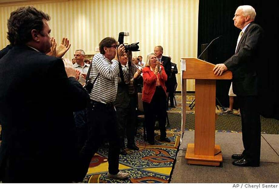 Republican presidential hopeful U.S. Sen. John McCain, R-Ariz., right, gets a standing ovation after speaking in Concord, N.H., Friday, July 13, 2007. (AP Photo/Cheryl Senter) Photo: Cheryl Senter