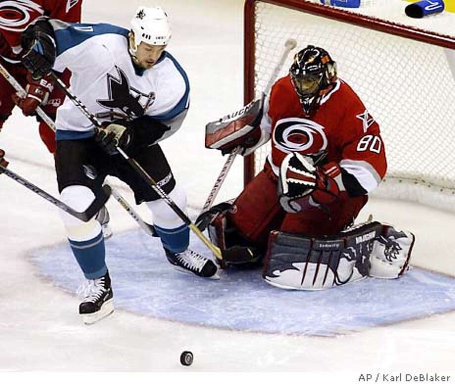 San Jose Sharks' Alyn McCauley (10) tries to contol a pass in front of Carolina Hurricanes goaltender Kevin Weekes (80) during the first period, Tuesday, Oct 28, 2003, at the RBC Center in Raleigh, N.C. (AP Photo/ Karl DeBlaker) Photo: KARL DEBLAKER