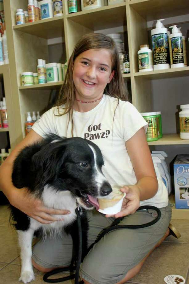 Customer Sydney Williams kneels with her happy, healthy puppy. (Contributed photo)