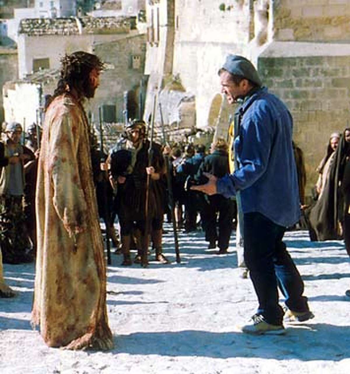 (NYT8) UNDATED -- Oct. 23, 2003 -- Mel Gibson, right, directs Jim Caviezel during filming of