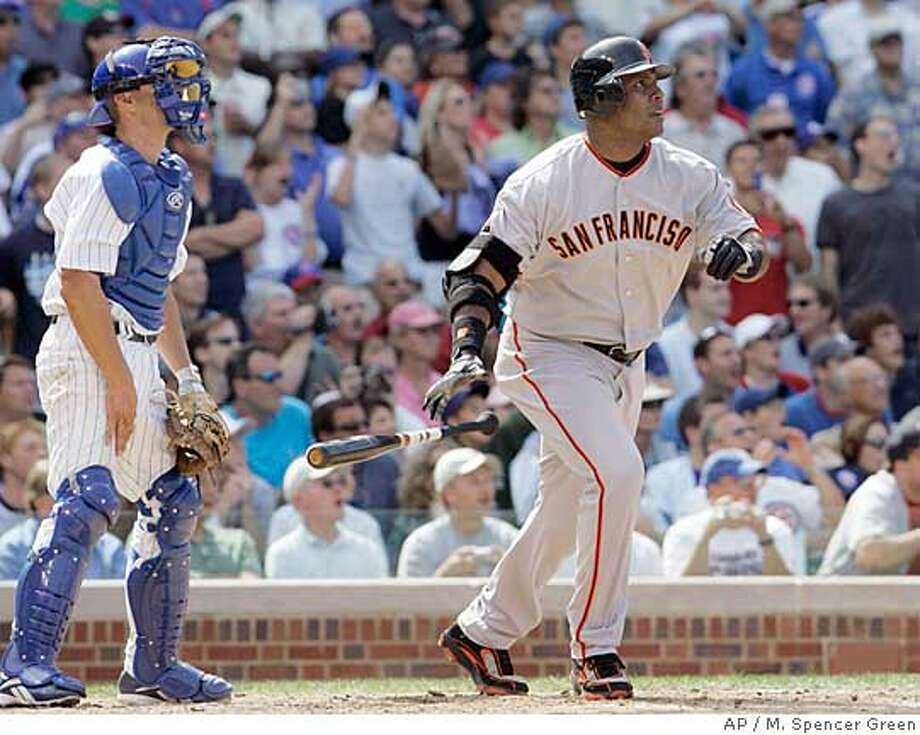 San Francisco Giants' Barry Bonds, right., and Chicago Cubs catcher Koyie Hill watch Bonds' three-run home run during the seventh inning of a baseball game against the Chicago Cubs Thursday, July 19, 2007 in Chicago. It was his 753rd career home run. (AP Photo/M. Spencer Green) Photo: M. Spencer Green
