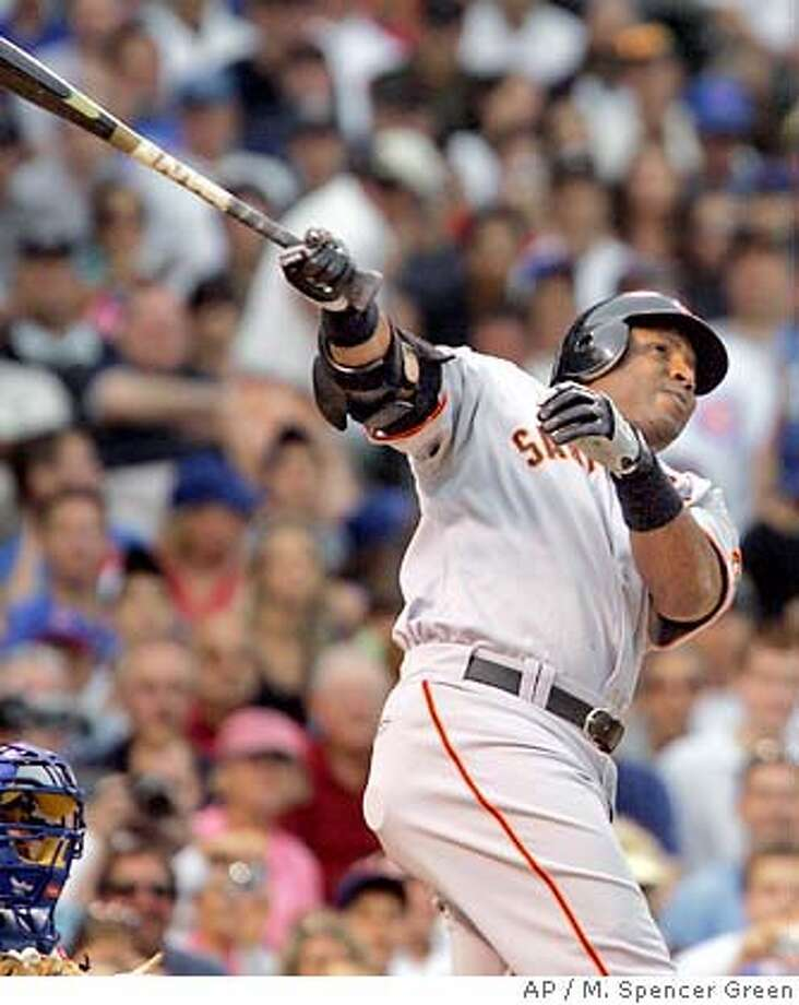 San Francisco Giants' Barry Bonds hits a home run during the second inning of a baseball game against the Chicago Cubs Thursday, July 19, 2007 in Chicago. It was his 752nd career home run. (AP Photo/M. Spencer Green) Photo: M. Spencer Green