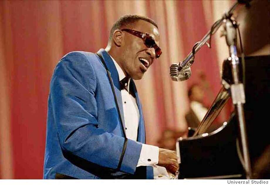 "Actors Jamie Foxx, star of the film ""Ray"" is shown as he portrays American music legend Ray Charles, in a scene from the film in this undated publicity photograph. Foxx received a best actor in a musical or comedy Golden Globe nomination for his role as Charles in the film and also received a best supporting drama actor nomination for his role in the film ""Collateral"" and another nomination in the TV movie or miniseries category, as best actor in ""Redemption"" as nominations were announced by the Hollywood Foreign Press Association in Beverly Hills December 13, 2004. The 2005 Golden Globe Awards will be presented in Beverly Hills January 16, 2005. NO SALES REUTERS/Universal Studios/Handout Ran on: 12-14-2004  Jamie Foxx channels Ray Charles in &quo;Ray.&quo; Foxx was also recognized for &quo;Collateral.&quo; 0 Photo: HO"