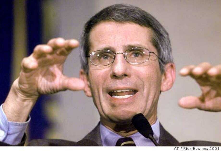 FILE--Dr. Anthony Fauci, director of the National Institute of Allergy and Infectious Disease gestures during an address on bioterrorism in this, Oct. 31, 2001 file photo at the National Institutes of Health in Behtesda, Md. Health and Human Services Secretary Tommy Thompson has been pushing for months to appoint Fauci to be National Instututes of Health director, but the White House will not sign off on him. (AP Photo/Rick Bowmer, Files)  ALSO RAN 11/5/02, 2/25/03 CAT DIGITAL IMAGE / OCT. 31, 2001 FILE PHOTO Dr. Anthony Fauci Nation#MainNews#Chronicle#12/13/2003#ALL#3star##421198094 Photo: RICK BOWMER