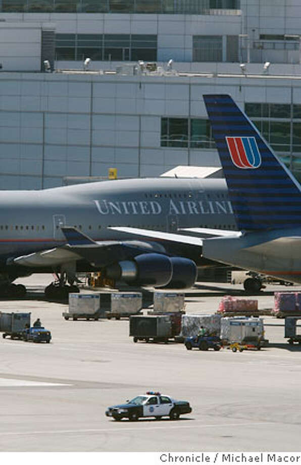 San Francisco International Airport personnel discovered the body of a man in the wheel well of a 747 recently arrived from Shanghai. The body was found during a post-flight inspection of United Airlines flight 858, at Gate 96 which landed at 7:42 a.m. after an 11-hour flight. Millbrae, Calif. Michael Macor / The Chronicle