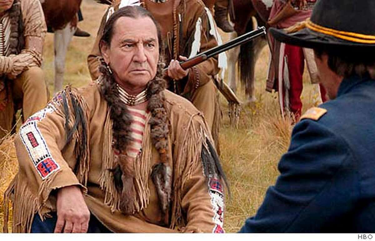An undated handout photo shows actor August Schellenberg (L) in a scene from the HBO mini-series 'Bury My Heart At Wounded Knee'. The show received 17 Primetime Emmy nominations, the most for any program, as nominations were announced for the 59th Annual Primetime Emmy Awards show in Los Angeles July 19, 2007. The will be presented in Los Angeles September 16, 2007. REUTERS/HBO/Handout (UNITED STATES). EDITORIAL USE ONLY. NOT FOR SALE FOR MARKETING OR ADVERTISING CAMPAIGNS. NO ARCHIVES. NO SALES.