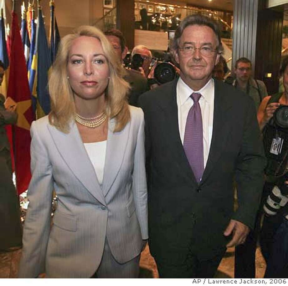 """** FILE ** Former CIA officer Valerie Plame, left, and her husband, former ambassador Joseph Wilson, arrive for a news conference at the National Press Club in Washington in this July 14, 2006, file photo. In an interview with The Associated Press in Santa Fe, N.M., Wilson says it will take a couple of years to sort through the remains of this recent period, in which the couple was """"dropped into the political maelstrom."""" (AP Photo/Lawrence Jackson, File) A JULY 14, 2006 FILE PHOTO Photo: Lawrence Jackson"""