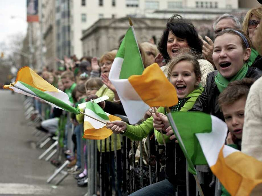 NEW YORK, NY - MARCH 17:  Revelers cheer on the marchers during the 251st annual St. Patrick's Day Parade March 17, 2012 in New York City. The parade honors the patron saint of Ireland and was held for the first time in New York on March 17, 1762, 14 years before the signing of the Declaration of Independence. Photo: Allison Joyce, Getty Images / 2012 Getty Images