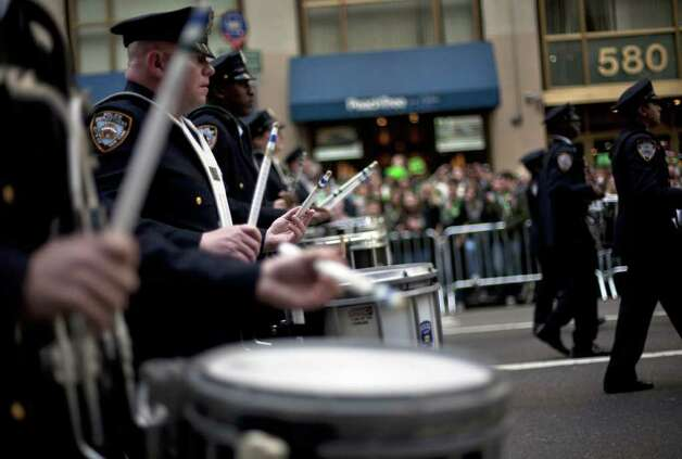 NEW YORK, NY - MARCH 17:  Marchers drum during the 251st annual St. Patrick's Day Parade March 17, 2012 in New York City. The parade honors the patron saint of Ireland and was held for the first time in New York on March 17, 1762, 14 years before the signing of the Declaration of Independence. Photo: Allison Joyce, Getty Images / 2012 Getty Images