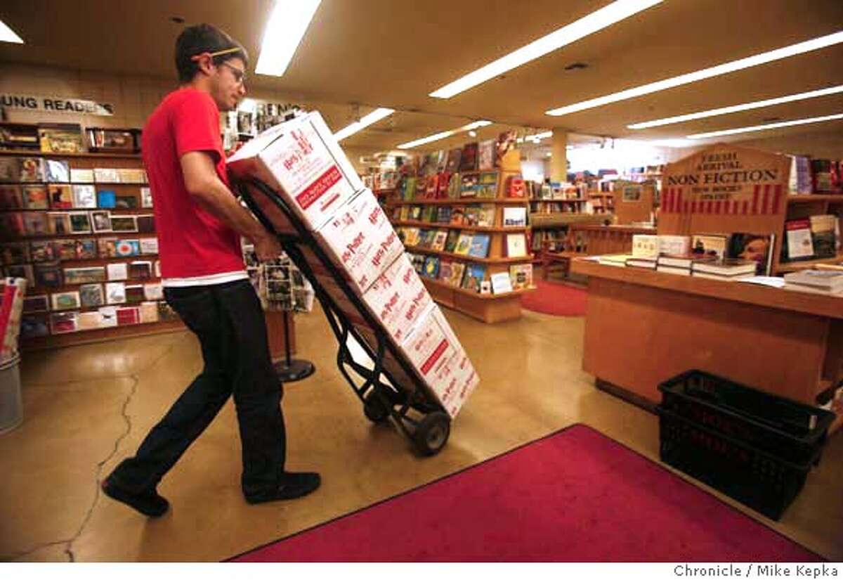 potter2000000157.JPG Loren Stewart, Moe's employee moves a stack of freshly delivered Harry Potter books to the safety of a downstairs storage closet. Moe's bookstore on Telegraph Avenue in Berkeley, CA will be releasing the book at 12:01 a.m. Sunday. 7/19/07. Mike Kepka / The Chronicle Loren Stewart (cq) 7/19/07. Ran on: 07-20-2007 Deathly Hallows arrives at Moes in Berkeley.