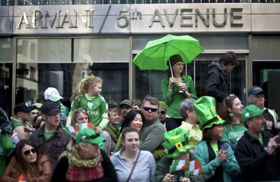 NEW YORK, NY - MARCH 17:  Revelers watch the 251st annual St. Patrick's Day Parade March 17, 2012 in New York City. The parade honors the patron saint of Ireland and was held for the first time in New York on March 17, 1762, 14 years before the signing of the Declaration of Independence. Photo: Allison Joyce, Getty Images / 2012 Getty Images