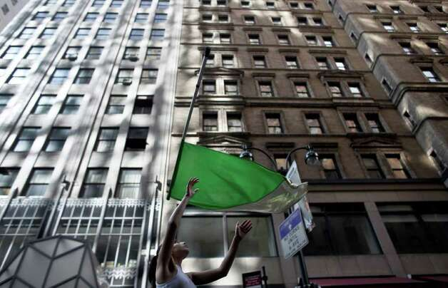 NEW YORK, NY - MARCH 17:  A woman throws a flag while marching during the 251st annual St. Patrick's Day Parade March 17, 2012 in New York City. The parade honors the patron saint of Ireland and was held for the first time in New York on March 17, 1762, 14 years before the signing of the Declaration of Independence. Photo: Allison Joyce, Getty Images / 2012 Getty Images
