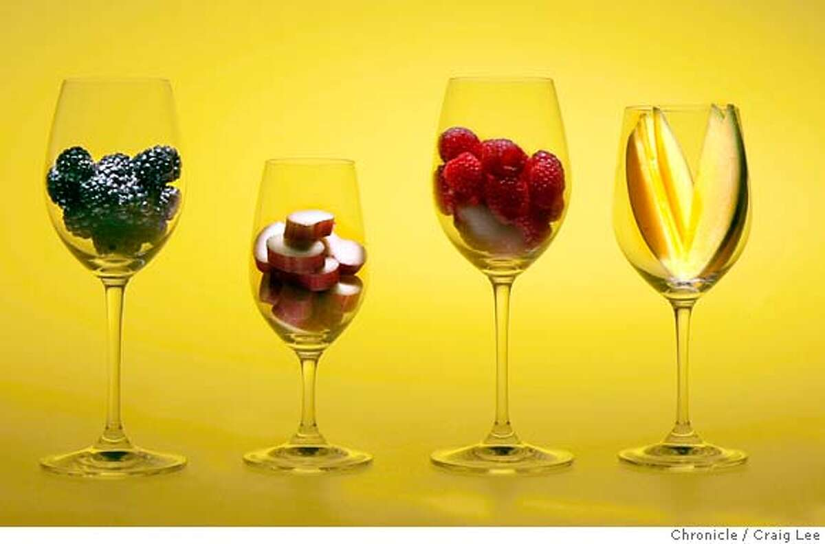 FRUITWINESS27_385_cl.JPG Story on fruit wines. Photo of fruits in wine glasses, left-right: Olallieberry, Rhubarb, Rasberry, and Mango. Event on 7/13/07 in San Francisco. photo by Craig Lee / The Chronicle MANDATORY CREDIT FOR PHOTOG AND SF CHRONICLE/NO SALES-MAGS OUT