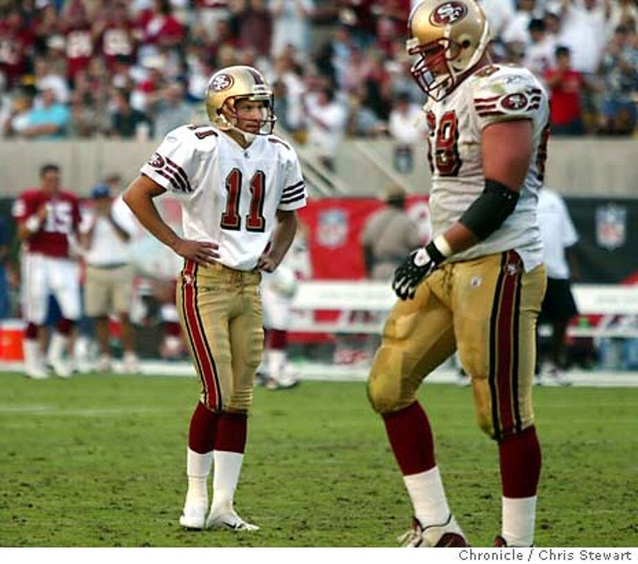 49ers0024_cs.jpg Event on 10/26/03 in Tempe. As his team mates leave the field, the San Francisco 49ers kicker Owen Pochman (11) ponders missing a 35 yard FG near the end of the fourth quarter, leaving the 49ers in a 13-13 tie. The game went to OT and the Niners lost 16-13 to the Arizona Cardinals at Sun Devil Stadium in Phoenix. The Niners are now 3 and 5 in the season. Chris Stewart / The Chronicle Photo: Chris Stewart