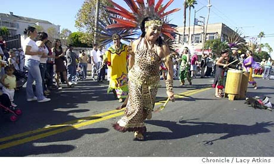 """Rebeca Flores dances with the """"Xitllali Dance Group"""" in a dance ceremony honoring the gods during the Immigrant Pride Day festival, at Mission and 24th, 10/26/03 in San Francisco, CA.This event was billed as a political and cultural festival to call attention asking for the right to vote for non-citizens in local elections.  LACY ATKINS / The Chronicle Photo: LACY ATKINS"""
