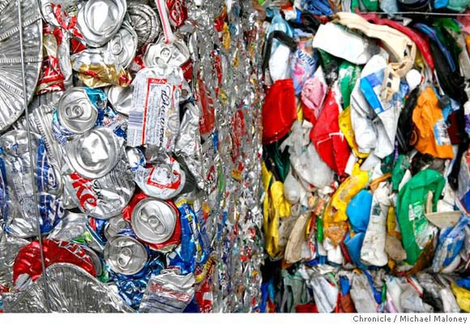 Bales of aluminum cans and plastic containers (background) wait to be picked up.  California Waste Solutions, Inc., is a privately owned recycling and waste management company operating in the San Francisco Bay Area since 1990. The San Jose City Council recently awarded CWS the franchise to both collect and process the city's single-family curbside recycling set-outs. Photos taken on Tuesday, July 10, 2007 in San Jose, CA.  Photo by Michael Maloney / San Francisco Chronicle *** Photo: Michael Maloney