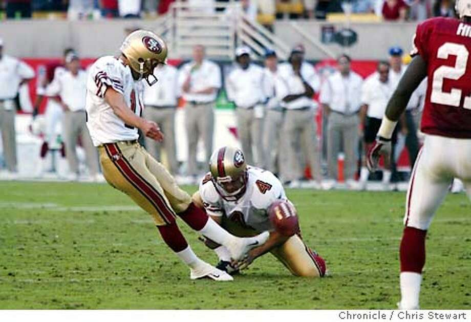 49ers0014_cs.jpg Event on 10/26/03 in Tempe. The San Francisco 49ers Owen Pochman (11) kicks and misses a 35 yard FG with 3:11 left in the fourth quarter, leaving them tied 13-13 with the Arizona Cardinals and forcing OT. The Niners lost 16-13 in OT to the Arizona Cardinals at Sun Devil Stadium in Phoenix. The Niners are now 3 and 5 in the season. Chris Stewart / The Chronicle Photo: Chris Stewart