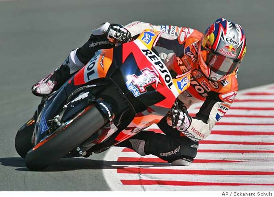 USA rider Nicky Hayden rides his Honda during a MotoGP class practice session of the Motorcycle Grand Prix Germany at the Sachsenring circuit in Hohenstein-Ernstthal, eastern Germany, Saturday, July 14, 2007. Hayden finished the race in third place. (AP Photo/Eckehard Schulz) Photo: ECKEHARD SCHULZ