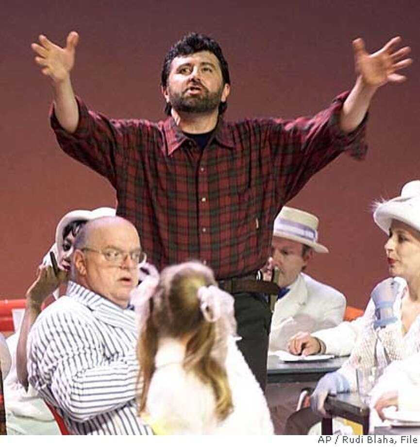 "**FILE** Tenor Jerry Hadley performs in a scene of a Bertolt Brecht's opera ""Der Aufstieg und Fall der Stadt Mahagonny"" in this July 19, 1998 file photo, during a rehearsal at the Salzburger Festival, in Salzburg, Austria. Opera singer Jerry Hadley died Wednesday, July 18, 2007, just more than a week after he was severely injured in an apparent suicide attempt, a family spokeswoman said. He was 55. (AP Photo/Rudi Blaha, File) A JULY 19, 1998 FILE PHOTO Photo: RUDI BLAHA"