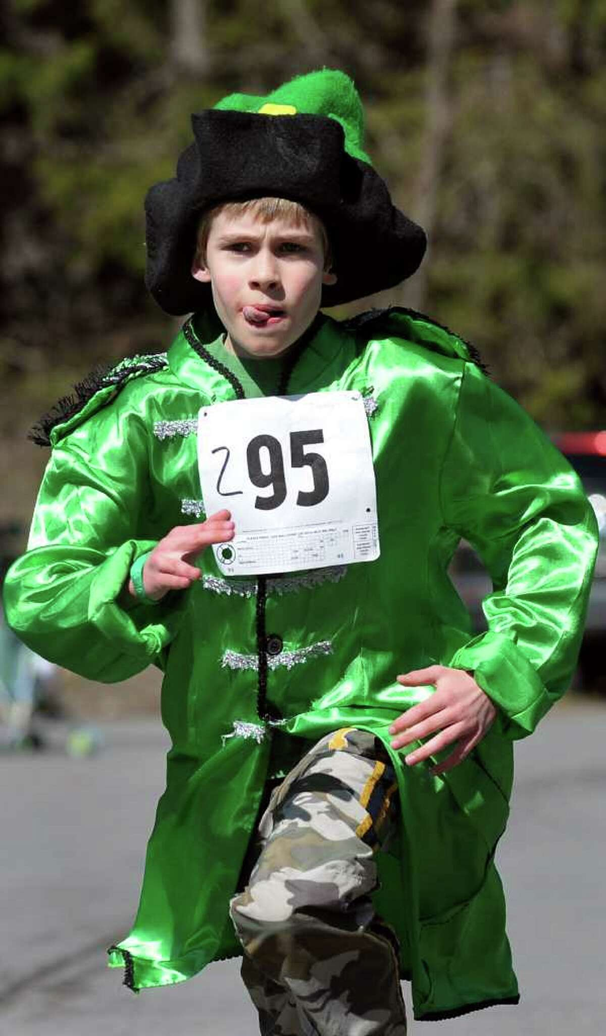 Dressed in a festive fashion, Charlie Dunigan, 9, of Averill Park runs the 1K Shamrock Shuffle for kids on St. Patrick's Day on Saturday, March 17, 2012, in Averill Park, N.Y. (Cindy Schultz / Times Union)