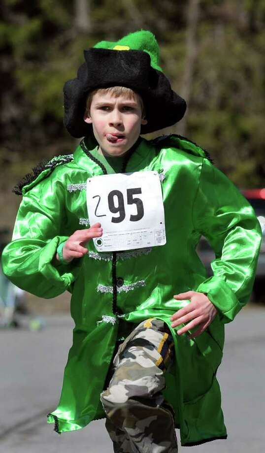 Dressed in a festive fashion, Charlie Dunigan, 9, of Averill Park runs the 1K Shamrock Shuffle for kids on St. Patrick's Day on Saturday, March 17, 2012, in Averill Park, N.Y. (Cindy Schultz / Times Union) Photo: Cindy Schultz, Albany Times Union / 00016417A
