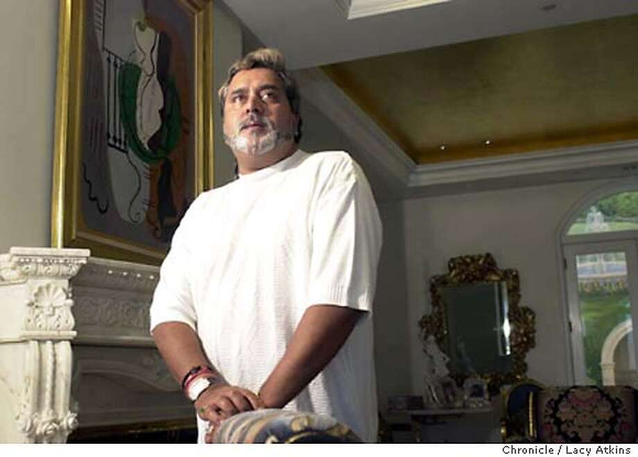 "PROFILE029_LA.jpg  Dr. Vijay Mallya , a member of the Parliament of India, owener of Mendocino brewing Company and many other companys, at his home in Sausalito, Tuesday Oct.7, 2003.  He owns the orginal Pablo Picasso ""Guitare Et Compotier Sur Un Gueridon"", painted in 1924 and worth between 3,000,000 and 4,000,000.  LACY ATKINS/ The Chronicle MANDATORY CREDIT FOR PHOTOG AND SF CHRONICLE/ -MAGS OUT Photo: LACY ATKINS"