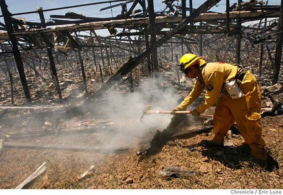 fire_052.JPG  CAL FIRE Neal Narayan works through some hot spots along one of the green houses.  Firefighters are mopping up hot spots after a blaze that destroyed a number of greenhouses in San Martin, south of San Jose just off Hwy 101 near the San Martin exit. Photographer:  Eric Luse / The Chronicle names (cq) from source  Neal Narayan MANDATORY CREDIT FOR PHOTOG AND SF CHRONICLE/NO SALES-MAGS OUT Photo: Eric Luse