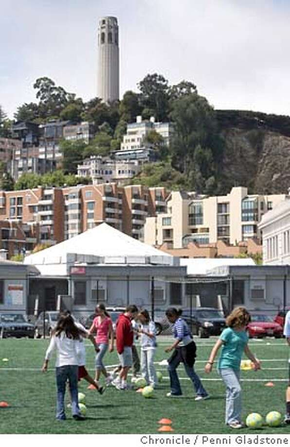PIERS18_092_PG.JPG Kids from the Embarcadero YMCA practice their soccer skills.  The future of some valuable real estate above and along Piers 27-31 has been the focus of epic political struggles over the past several years. Those struggles aren�t over but today the Port of San Francisco and the YMCA open a soccer field at the property that has been locked-up and largely unknown since it was built two years ago. The California Victory, San Francisco�s professional soccer team, was on hand to celebrate Event on 7/17/07 in San Francisco.  Penni Gladstone / The Chronicle MANDATORY CREDIT FOR PHOTOG AND SF CHRONICLE/NO SALES-MAGS OUT Photo: Penni Gladstone