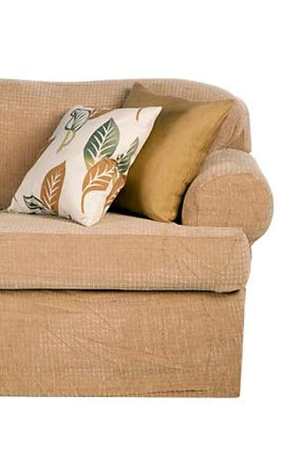 Slipcovers from Stretch & Cover are designed to fit snugly, stay in place and have a smooth upholstered look.