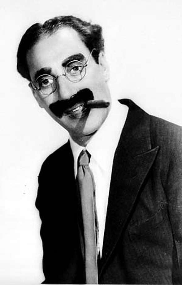 FILE--Comedian Groucho Marx is shown in this 1933 handout photo. Marx, who did more than smoke cigars and leer at women, was also a defender of free speech and U.S.-Soviet friendship. Documents recently made public show the FBI kept detailed files on the comedian, ranging from his supportive quote about the Scottsboro Boys in the 1930s to jokes made on television in the '50s and '60s. (AP Photo/Paramount)
