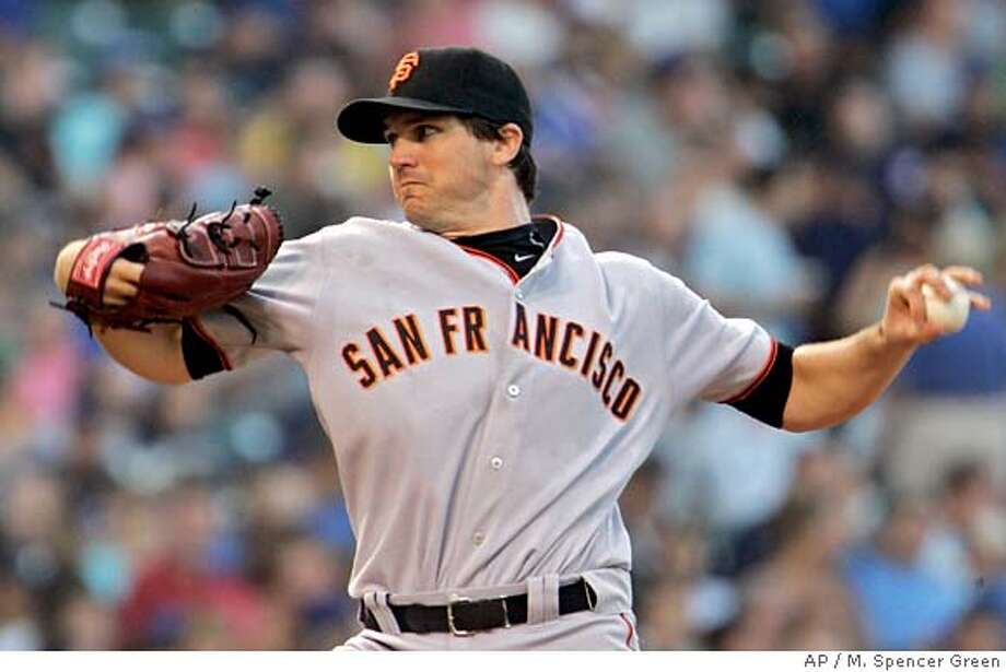 San Francisco Giants pitcher Barry Zito throws during the first inning of a baseball game against the Chicago Cubs Tuesday, July 17, 2007 in Chicago. (AP Photo/M. Spencer Green) Photo: M. Spencer Green
