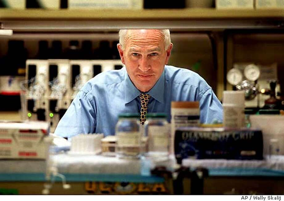 ** FILE** Dr. Don Catlin stands in the Olympic testing lab in Westwood section of Los Angeles in this July, 2000 file photo. The U.S. Anti-Doping Agency, which monitors drug use by athletes in Olympic sports, turned to Catlin when it received a syringe of the stuff from an unidentified track coach this summer. After weeks of extensive tests, Catlin and his colleagues identified the substance as a ``new chemical entity'' with all the hallmarks of an anabolic steroid. (AP Photo/The Los Angeles Times, Wally Skalij,file) JULY 2000 FILE PHOTO; , NO FOREIGN, MAGAZINES OUT , LOS ANGELES DAILY NEWS OUT, OC REGISTER OUT, VENTURA COUNTY STAR OUT MANDATORY CREDIT: WALLY SKALIJ/LOS ANGELES TIMES Photo: WALLY SKALIJ