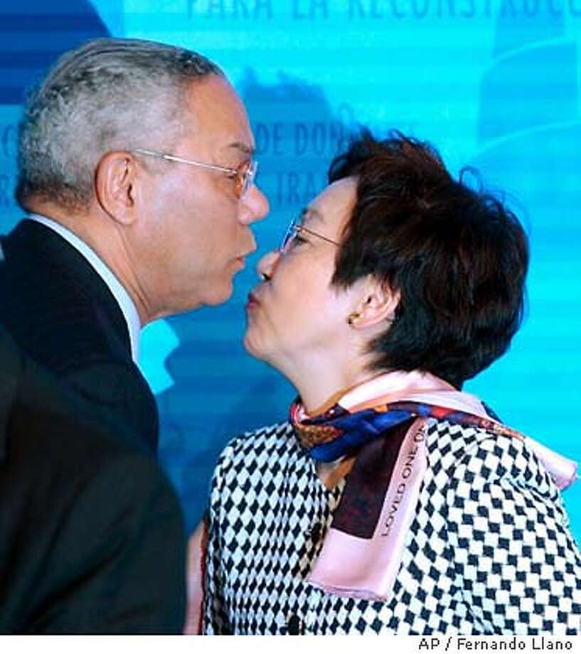 U.S. Secretary of State Colin Powell and Japan's Foreign Minister Yoriko Kawaguchi say goodbye at the end of the International Donor's Conference for the reconstruction of Iraq in Madrid, Spain Friday Oct. 24, 2003. (AP Photo/Fernando Llano) Photo: FERNANDO LLANO