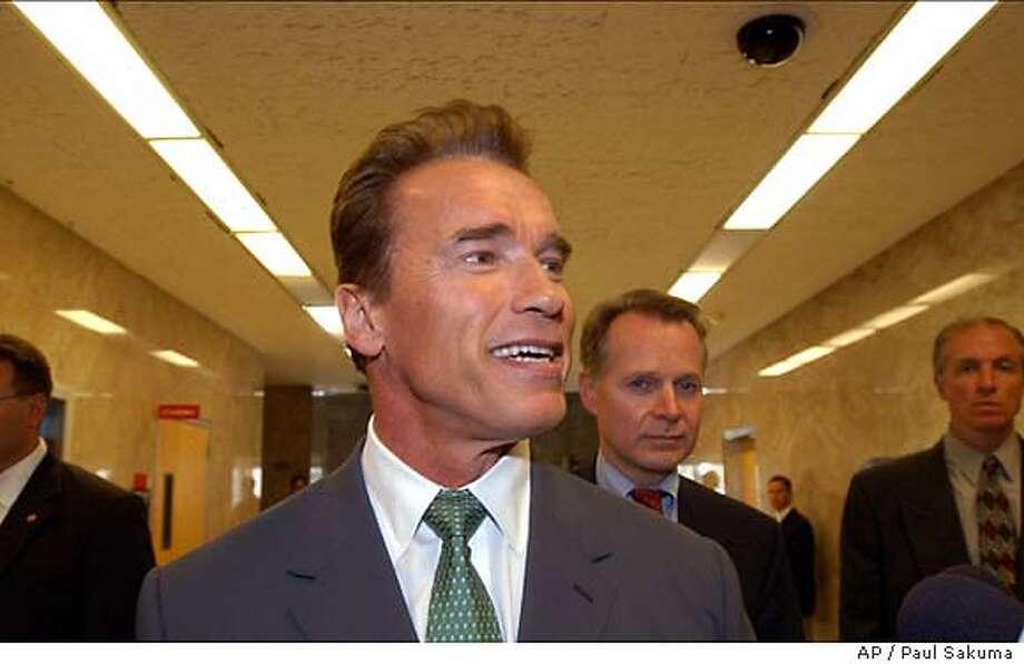 California Gov.-elect Arnold Schwarzenegger smiles after a visit to the offices of Gov. Gray Davis and Lt. Gov. Cruz Bustamante in the state Capitol in Sacramento, Calif., Thursday, Oct. 23, 2003. (AP Photo/Paul Sakuma) Photo: PAUL SAKUMA