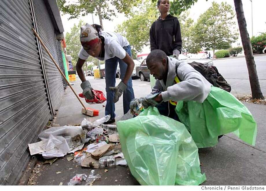 OAKTRASH_095_PG.JPG at left, Kayonie Coleman age 16 scoopes trash while 24 yr old Maurice Lewis holds open a trash bag for her. He is a team leader with Team Oakland. Standing is Angel Sims age 15 yrs.  the City of Oakland kicks off a community clean-up operation in the Elmhurst neighborhood. along International Boulevard between 81st Avenue and 98th Avenue. Event on 7/16/07 in Oakland.  Penni Gladstone / The Chronicle MANDATORY CREDIT FOR PHOTOG AND SF CHRONICLE/NO SALES-MAGS OUT Photo: Penni Gladstone