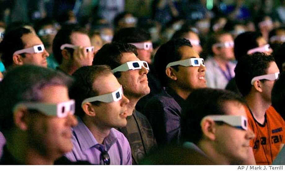 Audience members don 3-D glasses as Electronic Arts Casual Entertainment games are being demonstrated during a news conference, Wednesday, July 11, 2007, in Santa Monica, Calif. (AP Photo/Mark J. Terrill) Photo: Mark J. Terrill