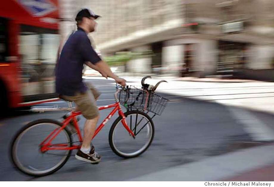 Mike Pyrich of Western Messenger Service pedals his bullhorn adorned single speed bike up Market Street in San Francisco. The 30 year old bike messenger says he used to see many more messengers workingstreets during his runs. The Internet (especially electronic case filing, e-tickets, PDF files etc) has caused a big decline in the bike messenger business. Lot of firms now have half as many messengers as they did five years ago.  Photo taken on July 13, 2007 in San Francisco, CA.  Photo by Michael Maloney / San Francisco Chronicle ***Mike Pyrich  Ran on: 07-17-2007  Mike Pyrich of Western Messenger Service pedals up Market Street. Photo: Michael Maloney