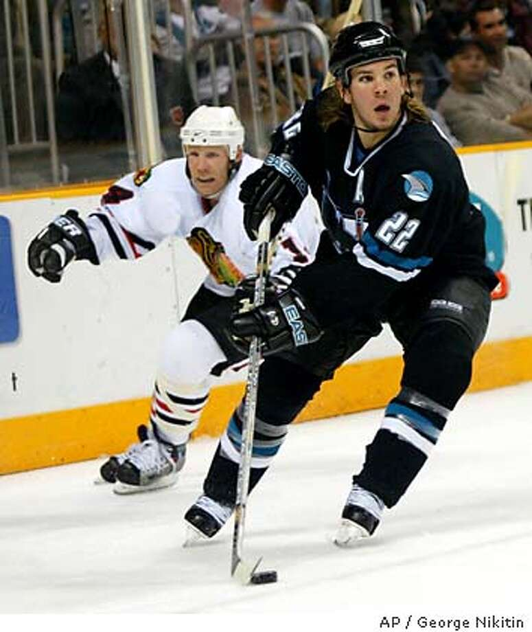 San Jose Sharks' Scott Hannan, front, is chased by Chicago Blackhawks' Ryan VandenBussche during the first period Thursday, Oct. 23, 2003, at the HP Pavilion in San Jose, Calif. (AP Photo/George Nikitin) Photo: GEORGE NIKITIN