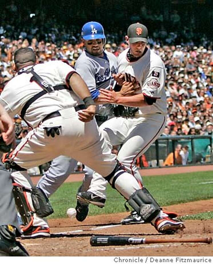 Matt Kemp is safe at home as he is sandwiched between Bengie Molina at left, and Noah Lowry who came in to cover the base. San Francisco Giants vs Los Angeles Dodgers at AT&T Park. Photographed in San Francisco on 7/15/07. Deanne Fitzmaurice / The Chronicle Photo: Deanne Fitzmaurice