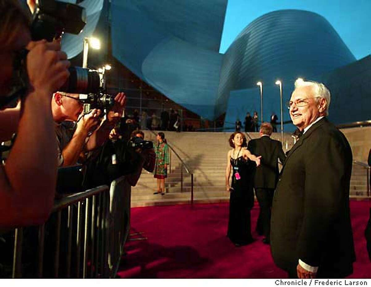 ; Frank Gehry the architect of the new Walt Disney Concert Hall in Los Angeles stop for photographers in from of his crown jewel in downtown LA. Los Angeles Philharmonic brought many Hollywood celebrity who walked carpet before the first performance. FREDERIC LARSON / The Chronicle