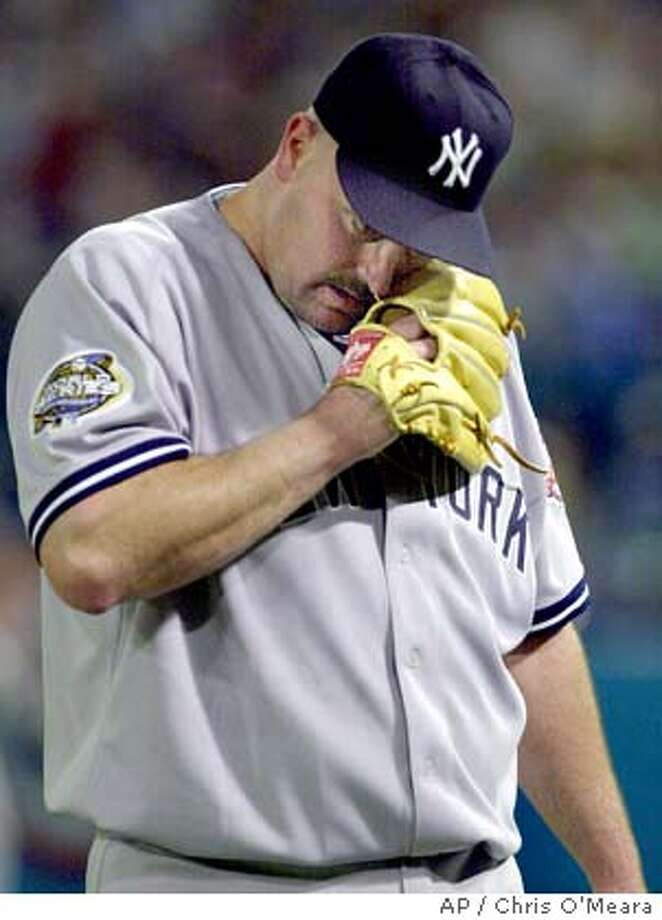 New York Yankees pitcher David Wells walks off the mound after the first inning against the Florida Marlins during game 5 of the World Series at Pro Player Stadium in Miami, Fla., Thursday Oct. 23, 2003. Wells left his start in Game 5 after only one inning because of lower back spasms. (AP Photo/Chris O'Meara) Photo: CHRIS O'MEARA