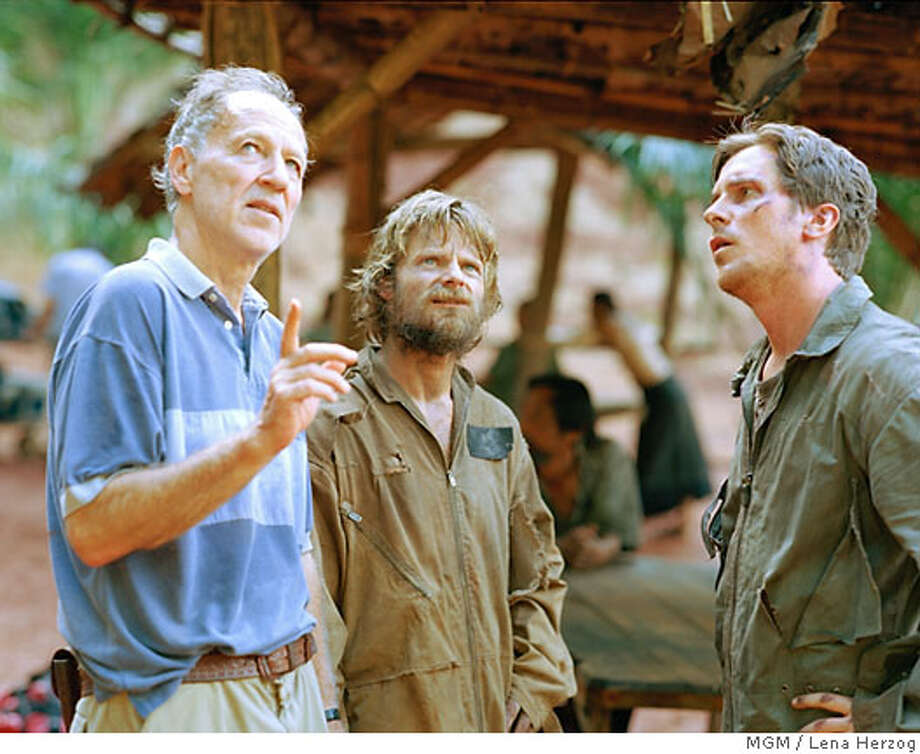 """Director Werner Herzog, Steve Zahn and Christian Bale on the set of """"Rescue Dawn""""  Ran on: 07-08-2007  Christian Bale in &quo;Rescue Dawn.&quo;  Ran on: 07-15-2007  Steve Zahn (left) and Christian Bale on the set of &quo;Rescue Dawn&quo;: It was a difficult shoot, Zahn says. Photo: Lena Herzog"""