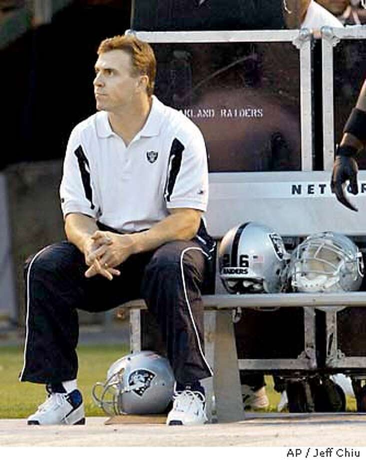 Injured Oakland Raiders' linebacker Bill Romanowski sits on the bench before the start of the first quarter against the Kansas City Chiefs on Monday, Oct. 20, 2003 in Oakland, Calif. (AP Photo/Jeff Chiu) Photo: JEFF CHIU